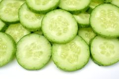Fresh cucumber slices. Fresh Cucumber and slices isolated over white background Stock Images