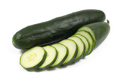Fresh cucumber and slices isolated on white Stock Photography
