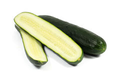 Fresh cucumber and slices isolated on white Royalty Free Stock Images