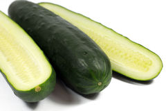 Fresh cucumber and slices isolated on white Stock Photo