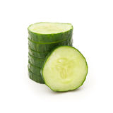 Fresh cucumber slices stack up on white Royalty Free Stock Images