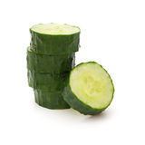 Fresh cucumber slices stack up on white background Stock Photo