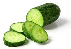 Fresh cucumber and slices on white background Royalty Free Stock Photography