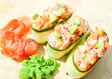 Fresh cucumber sushi with  salmon, roe and avakado Stock Images
