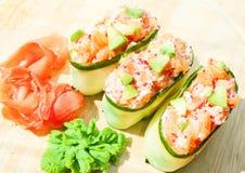 Fresh cucumber sushi with  salmon, roe and avakado Stock Images