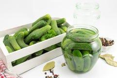 Fresh cucumbers in box prepared for jar. Fresh cucumbers in a wooden box putting in a jar Stock Photo