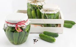 Fresh cucumbers in box prepared for jar. Fresh cucumbers in a wooden box putting in a jar Royalty Free Stock Photography