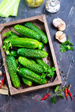Fresh cucumbers. In box and on a table Royalty Free Stock Photo