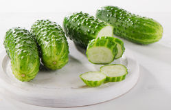 Fresh cucumbers on a cutting board. Selective focus Stock Images