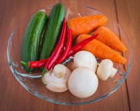 Fresh cucumbers, mushrooms, chili pepper, carrots, greens Stock Photography