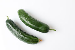 Fresh cucumbers on white wooden table. Fresh washed cucumbers on white wooden table Royalty Free Stock Images