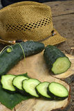 Fresh cucumbers on a wooden background Stock Images
