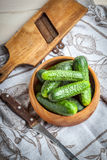 Fresh cucumbers in a wooden bowl. Royalty Free Stock Images