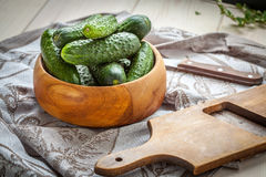 Fresh cucumbers in a wooden bowl. Stock Photography