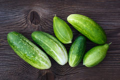 Fresh cucumbers on the wooden table. Stock Photos