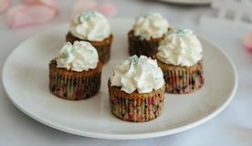 Fresh cup cakes on white plate. With whipped cream Royalty Free Stock Photography