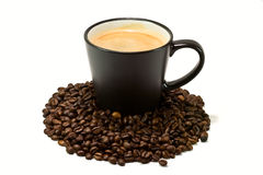 Fresh cup of coffee with beans Stock Photos