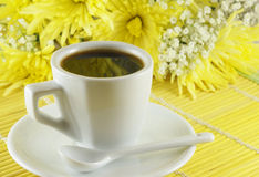 Fresh cup of coffee with flowers Royalty Free Stock Image