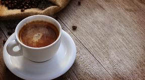 Fresh cup of coffee. Over wooden surface royalty free stock images