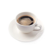 Fresh cup of coffee on a plate, isolated Royalty Free Stock Photos