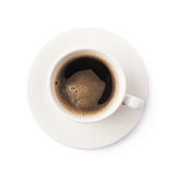Fresh cup of coffee on a plate, isolated Royalty Free Stock Images