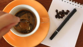 Fresh Cup Of Espresso With Notepaper On The Table stock footage