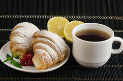 Fresh cup of hot black coffee with croissants and lemon Royalty Free Stock Photo