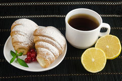 Fresh cup of hot black coffee with croissants and lemon Royalty Free Stock Photography