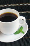 Fresh cup of hot black coffee with mint leaves Royalty Free Stock Image