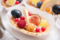 Fresh cupcake muffins with raw berries. Sweets decorated royalty free stock images
