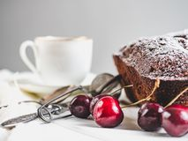 Fresh cupcake, ripe berries of a sweet cherry. Fresh, fragrant cupcake, ripe berries of a sweet cherry and a cup of aromatic coffee. Close-up stock images