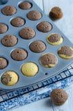Fresh cupcakes in baking pan Stock Images