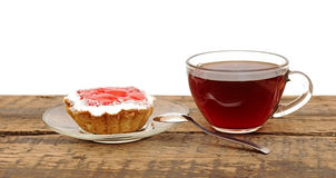 Fresh cupcakes and a glass cup tea Stock Photo