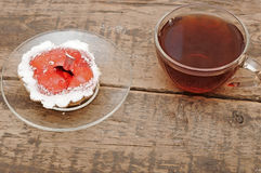Fresh cupcakes and a glass cup tea Stock Images