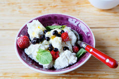 Fresh curd with raspberries in a bowl Royalty Free Stock Photos