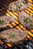 Fresh cured steak on the grill with fire Royalty Free Stock Photos