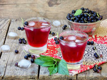 Fresh currant juice or compote with black currant. On table close up stock photos