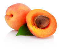 Fresh cut apricot fruits with leaf isolated on white background Stock Photos