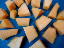 Fresh cut Cantaloupe in a pattern on blue Royalty Free Stock Photo