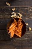Fresh cut carrot on wooden background Stock Images