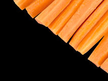 Fresh cut carrots, raw food snack isolated on black Stock Photography