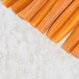 Fresh cut carrots, raw food snack on stone work surface Royalty Free Stock Images