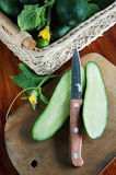 Fresh cut cucumber on the wooden cutting board Royalty Free Stock Photos