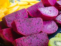 Fresh Cut Dragon Fruit, with Cut Mango Fruits and Kiwi. Fruits Royalty Free Stock Images