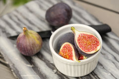 Fresh cut figs on table Royalty Free Stock Photo
