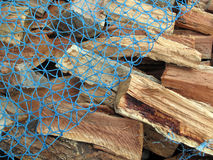 Fresh Cut Firewood with Netting Royalty Free Stock Image