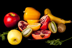 Fresh cut fruits on black Stock Photo