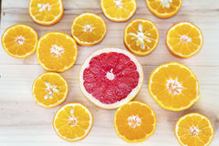 Fresh cut fruits citruses on a wooden   background. Royalty Free Stock Image