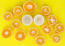 Fresh cut fruits citruses on a yellow  background. Stock Photos