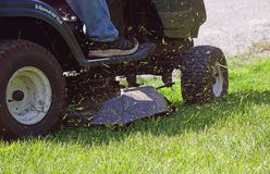 Fresh Cut Grass Flying From Riding Lawnmower Stock Images